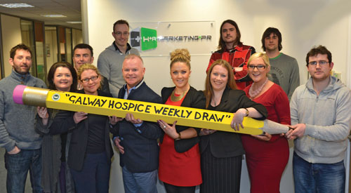 The team in H+A Marketing + PR with Galway Hospice fundraising manager Michael Craig & H+A Marketing + PR board member Joe Connolly signing up to the Galway Hospice Weekly Draw through a payroll deduction scheme in support of the Team Galway Hospice fundraising initiative.