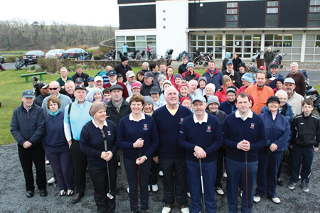 Leading the line: Maeve O'Farrell (Vice-Captain), Nuala Moody (Lady Captain), Pat Kearns (President), Christy Madigan (Gents Captain) and Joe Carty (Vice-Captain) line up in front of other members of Westport Golf Club for the Captain's Drive In.