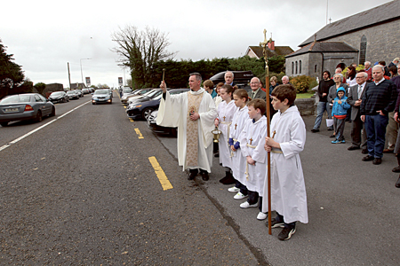 Fr John Kenny blessing the road outside Partry Church last Easter.