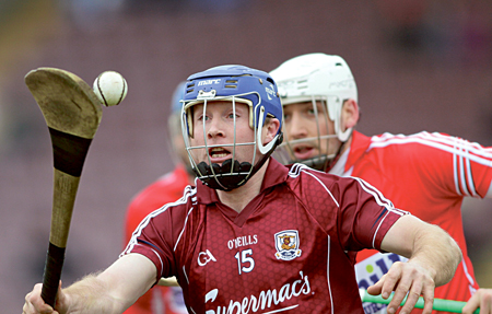 Galway's Damien Hayes gets away from Cork's Patrick Cronin. Photo:- Mike Shaughnessy