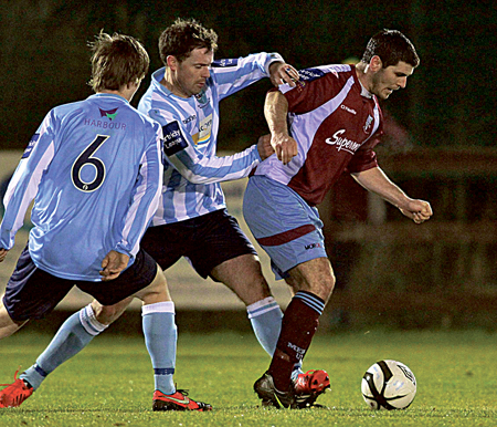 Mervue United's Gary Curran holds off Salthill Devon's Michael Harte in their recent clash.  Photo:-Mike Shaughnessy