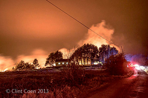The night sky lit bright by the flames near Barna on Monday night. Photo: Clint Coen