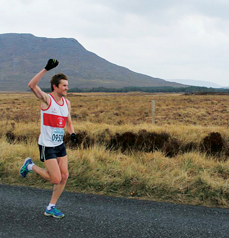 Galway's Matt Bidwell celebrates crossing the line in the Connemara half marathon at the weekend.
