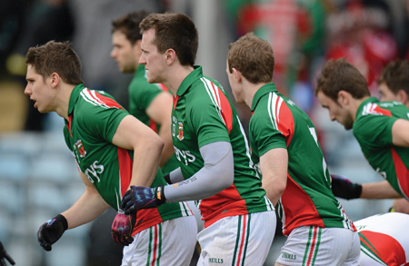 Here we go again: Lee Keegan, Cillian O'Connor and Colm Boyle break from the tunnel in Cork last Sunday before the game. All three will be key men for Mayo in Corke Park on Sunday. Photo:Sportsfile