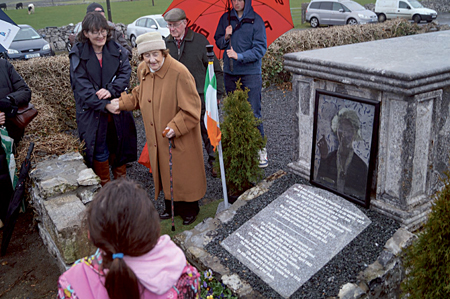 Unveiling of memorial stone at the O'Flaherty family vault in Donaghpatrick graveyard on April 17 to mark the 50th anniversary of the death of Eva O'Flaherty, born in nearby Lisdonagh House in 1874. Photo: Morgan Glynn.