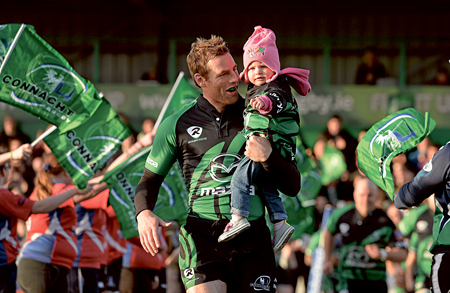Captain, leader, father: Ballina man Gavin Duffy carries out his 18-month-old daughter Jessica onto the field last week before Connacht's game with Ulster. Tonight Duffy and his team-mates will be away in Italy looking for league points.