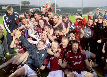 Above: Galway u-21 footballers celebrate victory over Cork on Saturday evening to claim the All Ireland crown. Below:  Galway captain and man of the match Fiontán Ó Curraoin denies Cork's Sean Kelly in the vital midfield battle. Photos: Mike Shaughessy