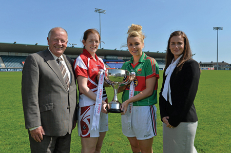 Ready for action: Mayo's Deidre Doherty (third) with Cork's Ann Marie Walsh (second) at this week's photocall ahead of tomorrow's Ladies' National Football League final. Also in the photo are Pat Quill, president of the Ladies' Football Association, and Lynn Moynihan, market manager with sponsors Tesco. Photo: Sportsfile.