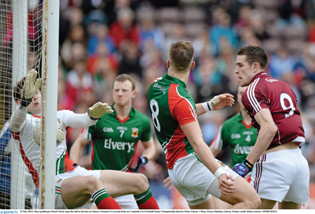 Eyes on the ball: David Clarke stops Fiontan O'Curraoin's effort on the line last Sunday, as Aidan O'Shea and Colm Boyle try to keep their eye on the ball. Mayo's steamrolling of Galway has set up a Connacht semi-final with Roscommon in Elverys McHale Park on Sunday, June 16. Photo: Sportsfile.