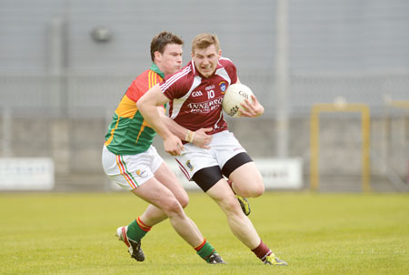 Kieran Martin gets by Carlow's John Murphy during last Sunday's championship fixture.  Photo: johnobrienimages.com