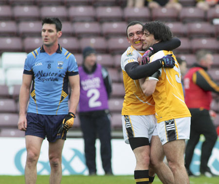 Carna Caiseal's Colm Ó Dúbháin and Marc MacFhlannchadha celebrate their victory over Salthill Devon in the opening round of the Galway County Senior Football Championship at Pearse Stadium on Saturday.