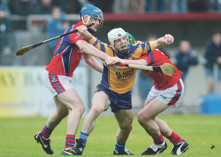 Andrew Smith of Portumna is held by Sean and David Burke of St Thomas in action from the senior hurling championship game at Kenny Park, Athenry, on Sunday. 						Photo:-Mike Shaughnessy