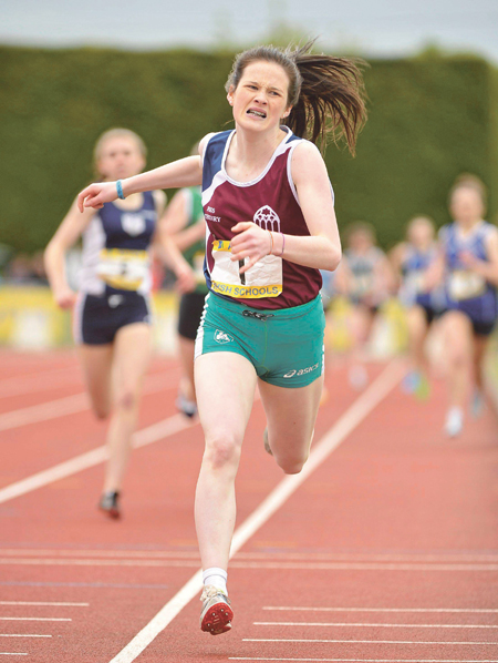 Alanna Lally of Presentation Athenry crosses the finish line to win gold in intermediate girls' 800m at the Irish Schools Athletic Championships.