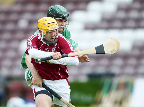 Athenry's Jack Gibbons clashes with Moycullen's Ronan Higgins in the Galway Senior Hurling Championship qualifier game in Pearse Stadium on Saturday. 							Photo:-Mike Shaughnessy