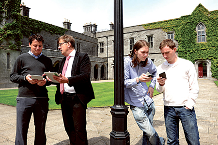 Students receiving the marks on their phones — Dr Thomas Kropmans and Wexford native David Cunningham watch applications of their technology at NUI, Galway this week. Photo: Boyd Challenger