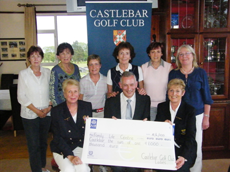 Charity winners: The charity day golf competition and social gathering held on Wednesday June 15 at Castlebar Golf Club was an outstanding success. In excess of €2,000 was collected for the benefit of two charities. The presentation of cheques was made in the clubhouse last week to representatives of The Family Centre and to Faith and Light Castlebar. Pictured is Cathal Kearney, representing The Family Centre pictured receiving a cheque for €1,000.