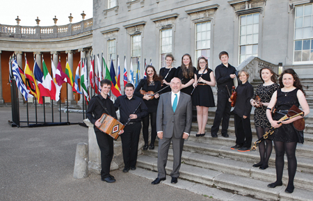 Members of Gealóga, The Music Generation Mayo Traditional Music Ensemble, pictured with Minister for Education and Skills, Ruairí Quinn at an EU presidency event in Castletown House, Kildare. L-R: Patrick Boyle, Alan Judge, Kate Heneghan, Catherine Lambe, Marianna Tiernan, Grace McDonnell, Seán McGreal, Donal Parkinson, Orla Mannion, Niamh Mulhern, absent from image: Ellen Murphy