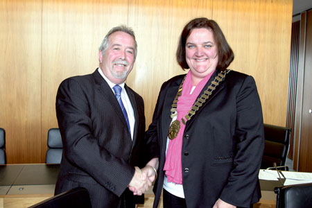 New mayor of Athlone Cllr Gabrielle McFadden receives the chain of office from outgoing mayor Cllr Jim Henson. Photo: molloyphotography