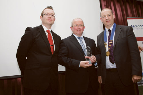 Pat Gallagher, manager Offaly County Council, receives the Ambassador award on behalf of Conor Brady. Also pictured are Will Faulkner of Midlands 103 and John Humphries, president of the Midlands Gateway Chamber.