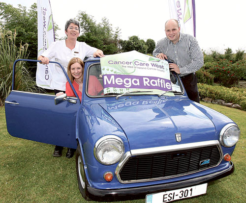 Trying out the Mini — Nurse Mairead Connelly and Jill Taylor, operations manager at the Cancer Care West residential facility Inis Aoibhinn and David O'Donnell, fundraising manager at Cancer Care West.