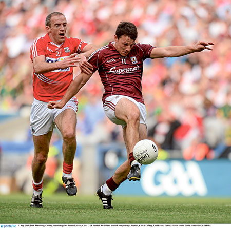 Sean Armstrong, Galway, in action against Paudie Kissane, Cork.  Picture credit: David Maher / SPORTSFILE