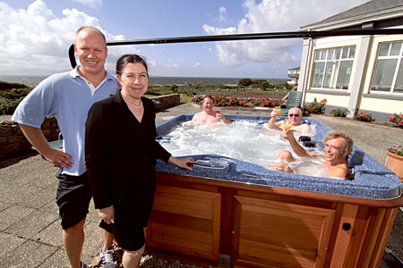 George Bisser, The Coast Club leisure centre manager, and Ann Downey, general manager of the Connemara Coast Hotel, with longstanding members of The Coast Club, pictured enjoying the new outdoor hot tub. The long anticipated wait for the instillation of the new outdoor hot tub was welcomed with a rousing round of applause, bubbles, and a splash. This is a great addition to the club which already has a pool, gym, sauna, steamroom, and Jacuzzi. See www.connemaracoast.ie   Photo: Mike Shaughnessy.