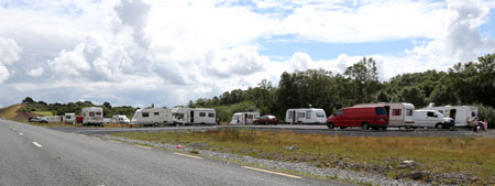 Pictured are the cars, vans, caravans and camper vans which were parked illegally at the entrance to the scenic Rehins Wood outside Castlebar this week before moving to another site on the Turlough Road.