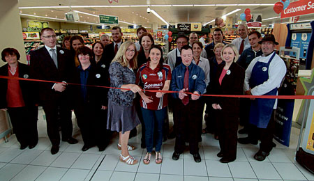 Cllr Nuala Nolan holds the ribbon for Tesco staff and stars of the sporting world Ailish O'Reilly Galway Camogie and Special Olympics silver medalist in kayaking Ruairi O'Toole at the reopening of the refurbished Tesco store at the Galway Shopping Centre Monday. 			Photo:-Mike Shaughnessy