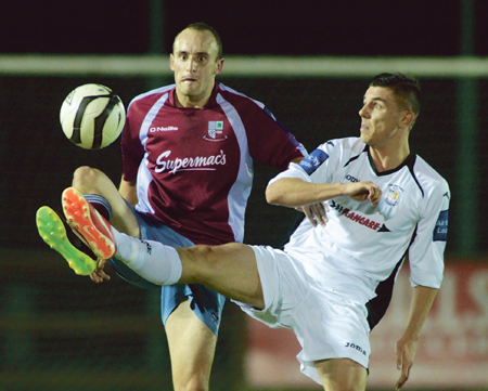 Mervue United's Martin Conneely and Athlone Town's Enda Curran clash in action from the Airtricity League game at Fahy's Field on Friday night.      Photo:-Mike Shaughnessy