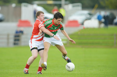 Garrycastle's Gary McCallon is tackled by Clive Kiernan during last weekend's championship outing. Photo: John O'Brien