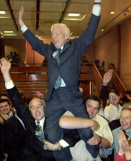 Padraig McCormack being held aloft by Eamon King and Mike Connor after he won his seat in 1989.