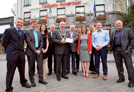 Mayor Padraig Conneely pictured with Advertiser management pushing the button to launch the Advertiser's classified ads website on Tuesday.