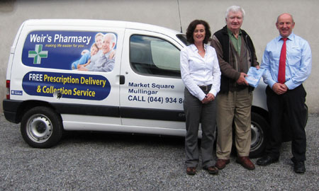 Picture shows Seamus Hunt availing of the new prescription delivery service. Also pictured are Weirs pharmacists Niall Weir and Catherine Muckian.