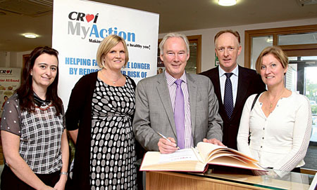 Pictured signing the visitors' book during his visit to the Croí Heart & Stroke Centre, Moyola Lane, Newcastle, Galway. Photo shows (left to right): Irene Gibson, Croí prevention nurse lead; Jenni Jones, Croí director of prevention programmes, Prof David Wood, Garfield Weston Professor of Cardiovascular Medicine; Neil Johnson, CEO Croí; and Caitriona Jennings, cardiovascular nurse specialist, Imperial College London.