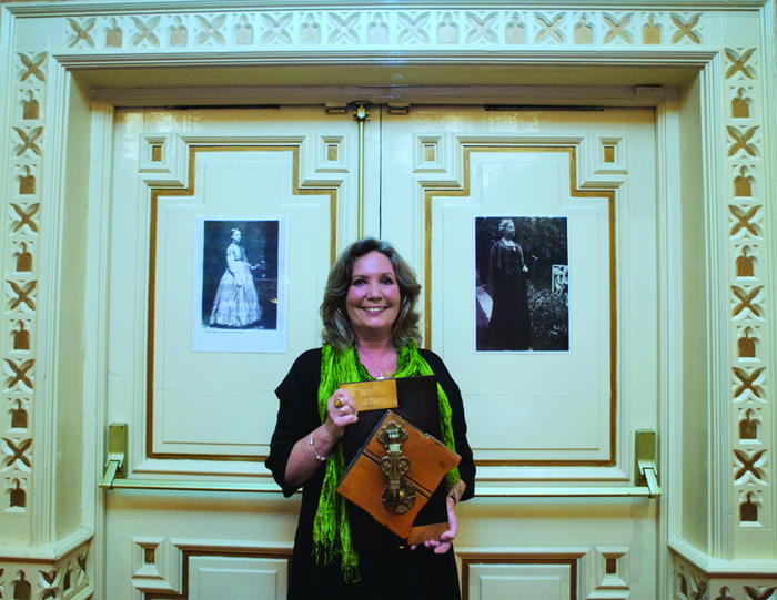 Knock on wood: Nuala Hayes with the Coole door knocker mounted on wood which came from the original door.