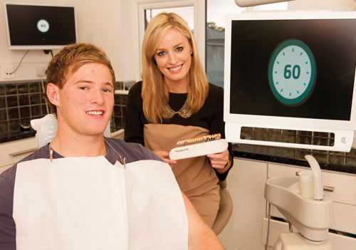Professional rugby player Kieran Marmion, pictured with Dr Lisa Creaven of Quay Dental, trials the new one hour 'in chair' cosmetic whitening at Quay Dental. Pic: Reg Gordon