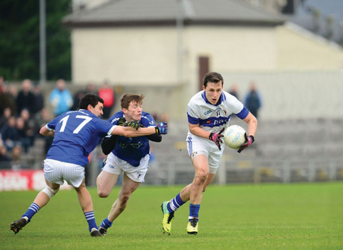 St Loman's Steven Gilmore and Jason O'Toole close down St Vincent's Adam Baxter during last Sunday's Leinster Championship quarter final. Photo: John O'Brien