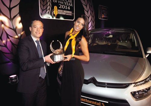 The Citroen C4 Picasso was voted the Continental Irish Car of the Year 2014. Pictured are Frederic Soulier, managing director, Citroen Motors Ireland with model Adrienne Murphy.