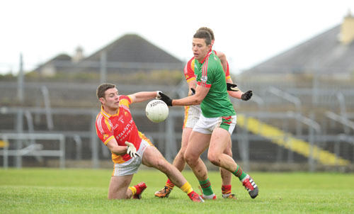 St. Brigid's Karol Mannion and Castlebar's Tom King battle for possession during last Sunday's Connacht final. Photo: John O'Brien