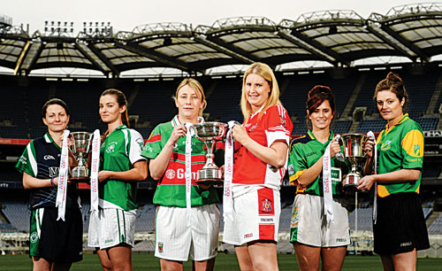 Hands out: Majella Walsh (Donaghmoyne) and Marie Corbett (Carnacon) look to get their hands on the Dolores Tyrrell Cup at the launch of the Tesco Homegrown Ladies Gaelic All Ireland Senior club finals. Photo: Sportsfile