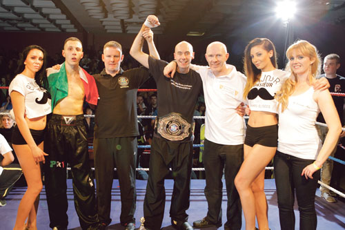 Pictured are: Ringcard girl; Alessandro Disnan, Italian champion and world No 3;  Paul Cummins, referee, Kilkenny;  Castlepark's Gary 'Slick' Manogue, the new IKF World Super Welterweight champion;  Pete Foley, Galway coach;  Ringcard girl; and Aoife Warde of sponsor Eastside Inn. Photo: John Walsh.