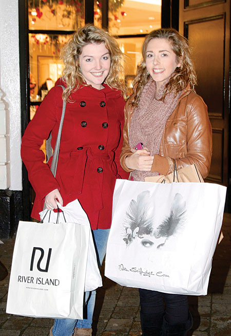 Breffni Molloy of Milltown and Danielle Carroll of Tuam getting their Christmas shopping all wrapped up on Monday in Galway