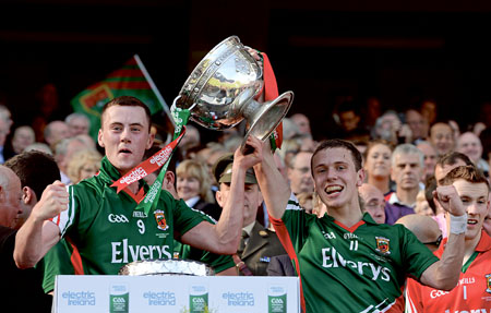 For club and county: Diarmuid O'Connor and Michael Plunkett with the Tom Markham Cup after the Mayo minors win over Tyrone in the All Ireland final. Photo: Sportsfile.