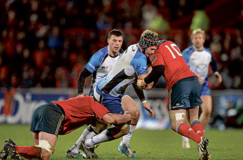Connacht captain Craig Clarke is tackled by Munster's Dave Foley and JJ Hanrahan in a niggly post-Christmas Pro 12 game at Thomond Park.