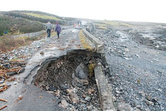 Roads across the county like this one on Inis Mor have been left destroyed with families and communities cut off from vital access. Photo: Robert Kelly