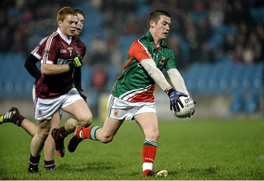 Mikey Sweeny heads for goal against NUIG on Friday night. Photo:Sportsfile
