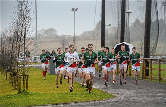 Marching in the rain:Mayo make their way to the field in Bekan. Photo:Sportsfile
