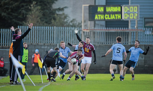 Westmeath manager Paul Bealin appeals for a free as linesman Noel Mooney keeps a close eye as Westmeath's Ger Egan is tackled by Dublin players Kevin McManamon and Ciaran Reddin in the fifth minute of the game