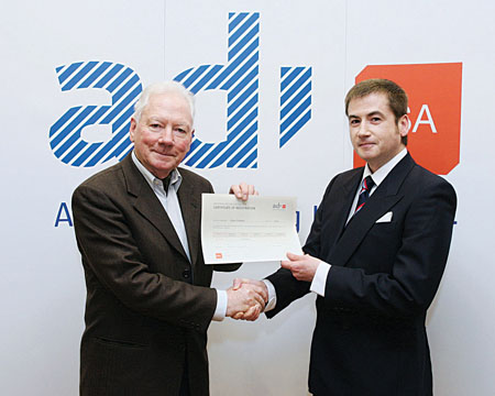 Alan Graham was the first person in Ireland to be presented with the Approved Driving Instructor (ADI) Certificate. He is pictured here receiving it from RSA chairman Gay Byrne.