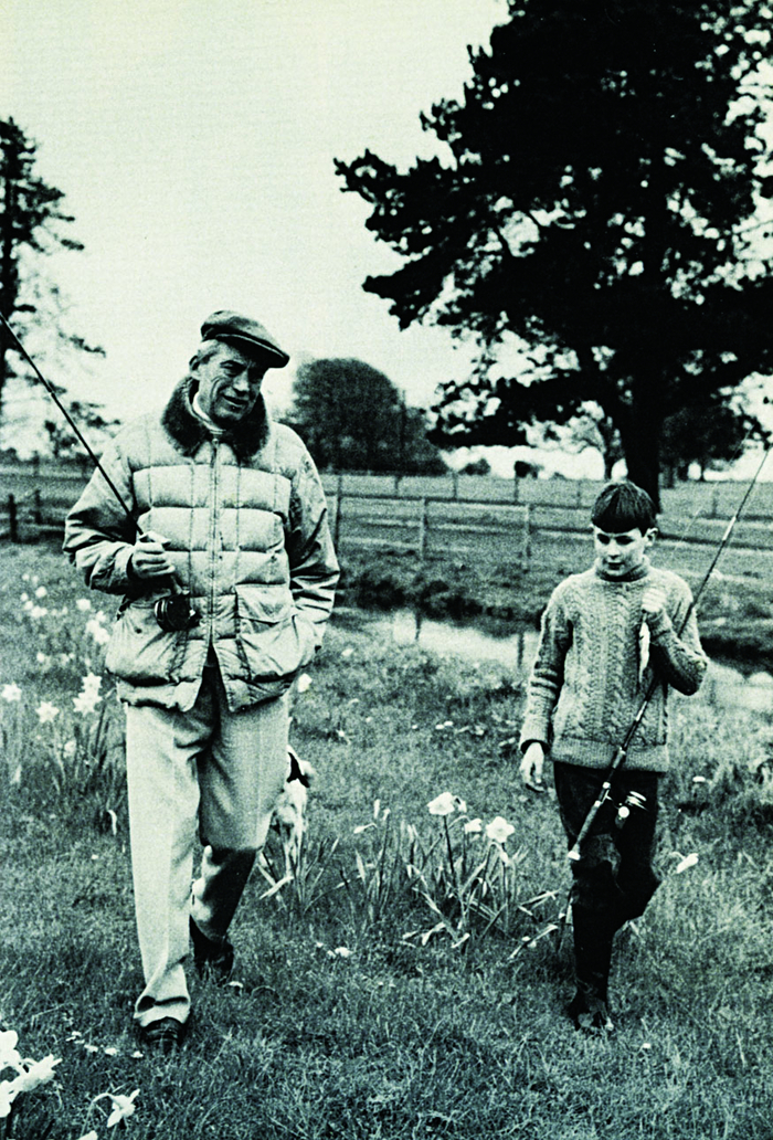 Small fry: John Huston  and his son, Tony, walk  home from fishing at St Clarens (note the catch of the day). Tony became an expert fly-fisherman.
